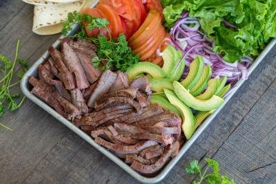 tray with flank steak and vegetables for the wrap