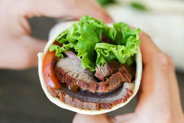 Flank steak wrap in hands