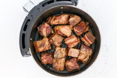 Pork ribs in an air fryer basket