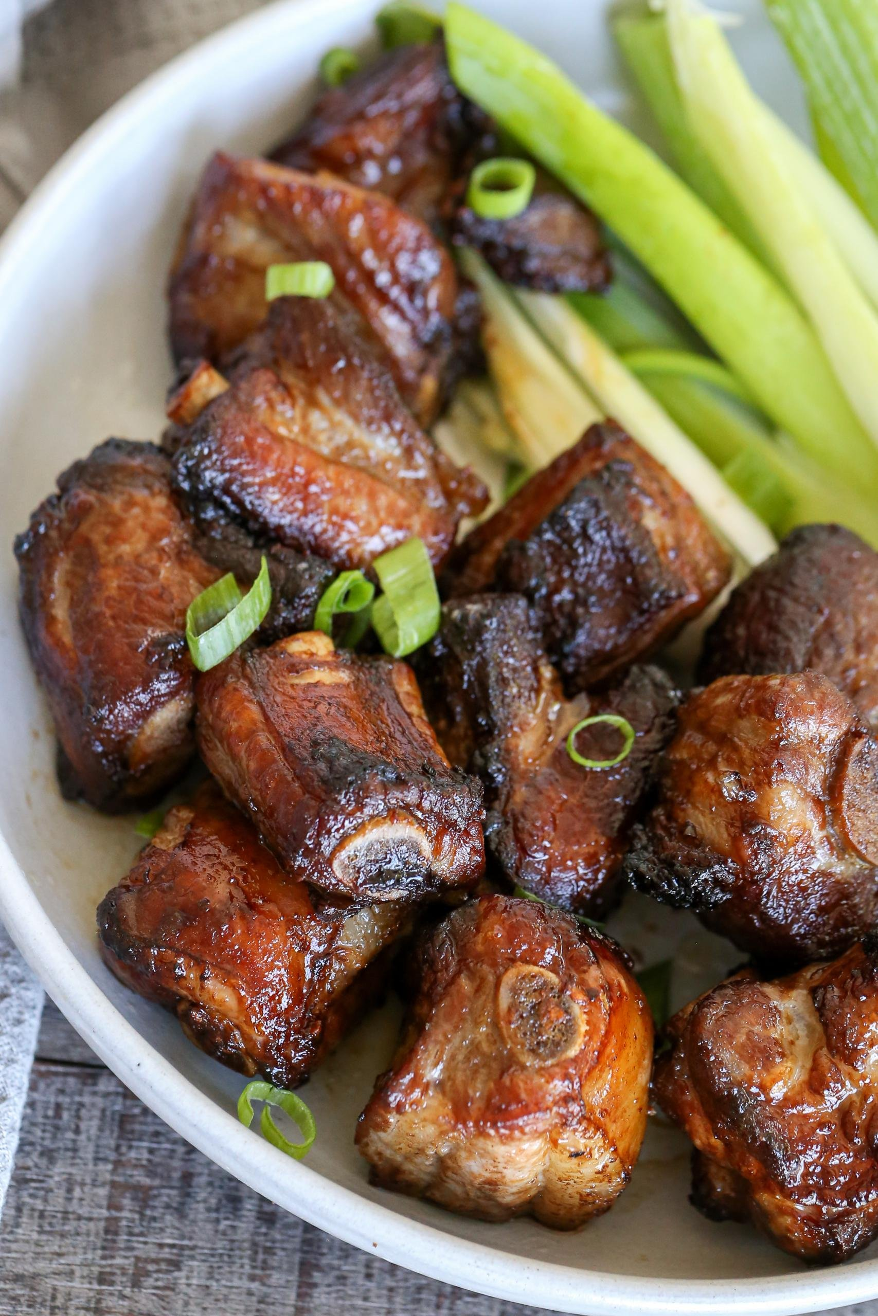Pork Ribs in a plate with green onions