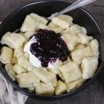 Lazy Pierogi in a bowl with jam and sour cream