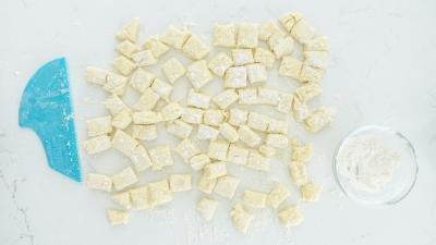 Pierogi dough cut into pieces