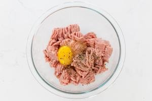 ground meat and egg in a bowl