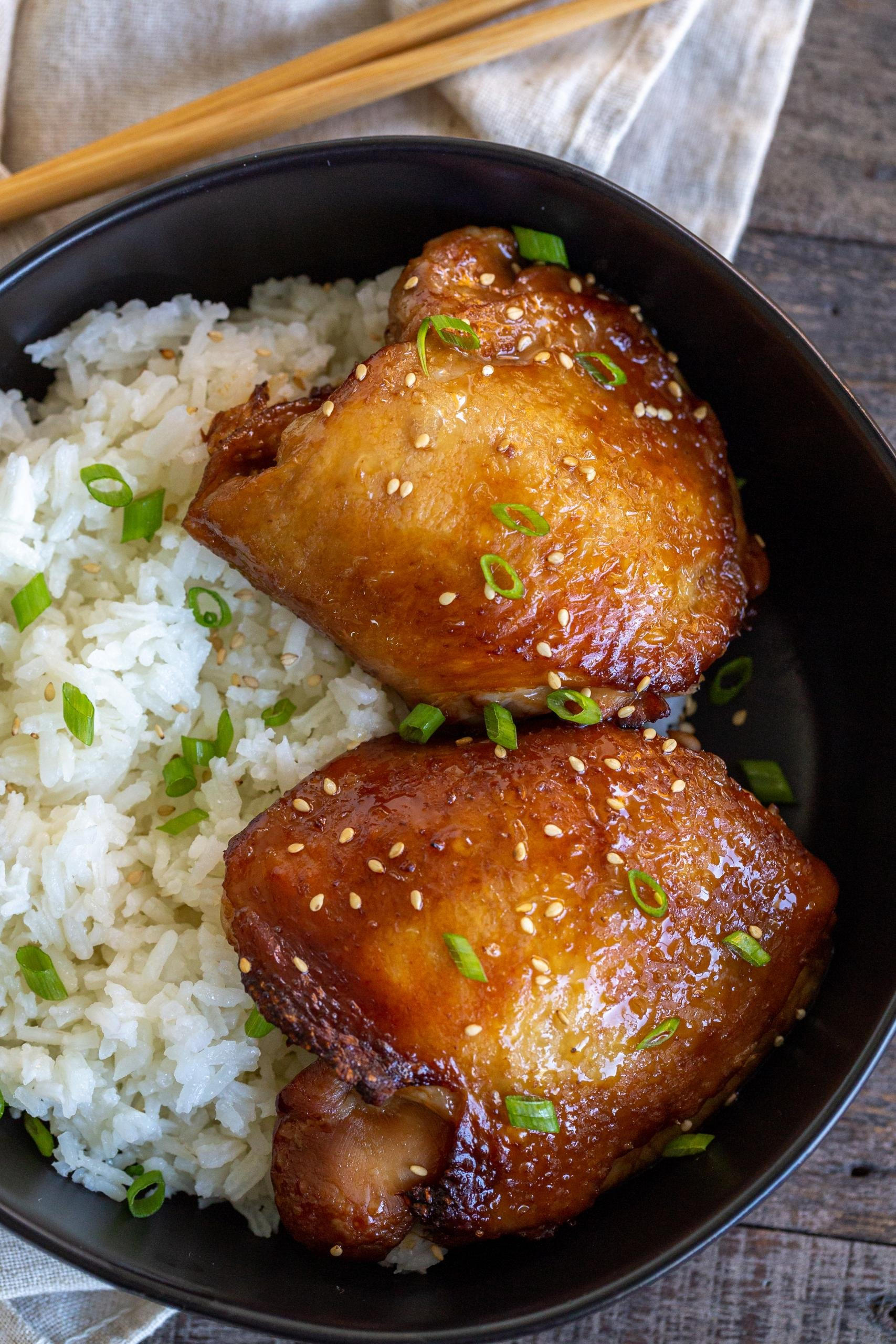Korean Chicken Thighs in a bowl with rice