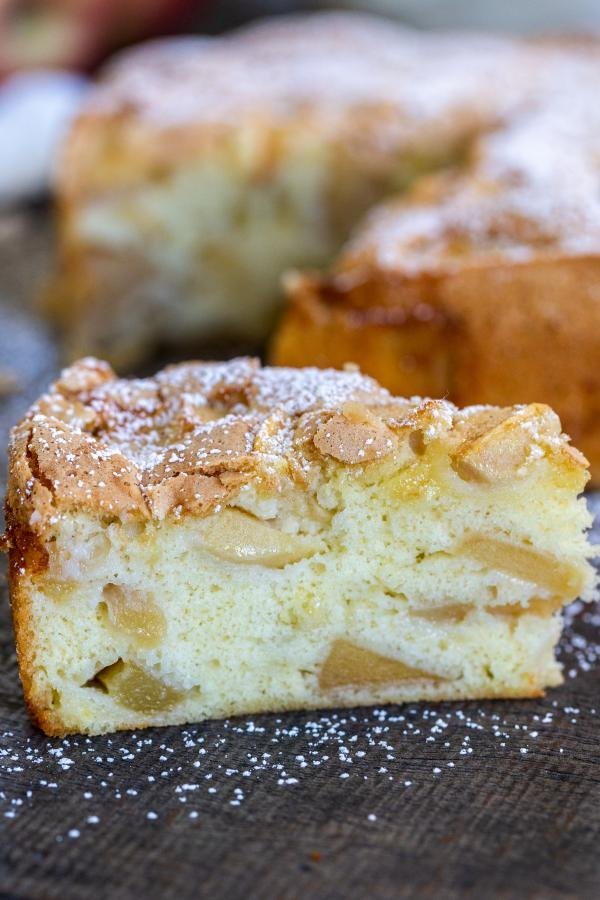 A slice of apple cake with powdered sugar
