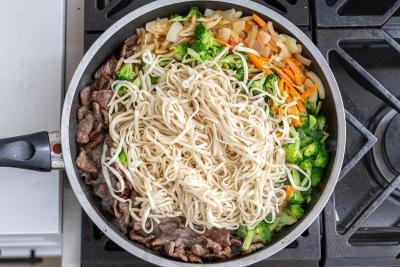 noodles with beef and veggies in a skillet