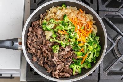 beef and vegetables in a skilet