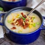 Creamy potato soup with bacon, cheese and onions