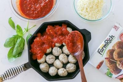 Meatballs with Marinara sauce in a cooking pan