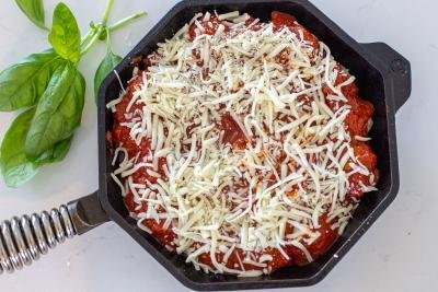 meatballs covered with cheese and marinara