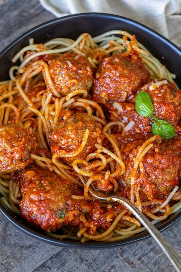 Meatballs with spaghetti and marinara sauce in a bowl