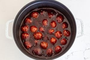 Meatballs in a pot with grape jelly sauce