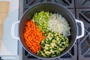 zucchini, onion, celery and carrots in a pot