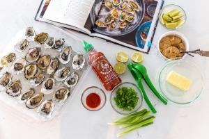 Ingredients with recipe book for the smoked oysters