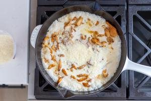 Frying pan with sauce and chanterelle mushrooms