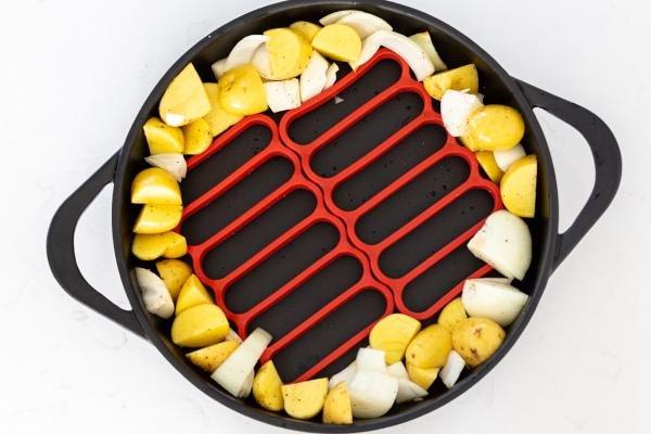 Pan with veggies and a roasting rack