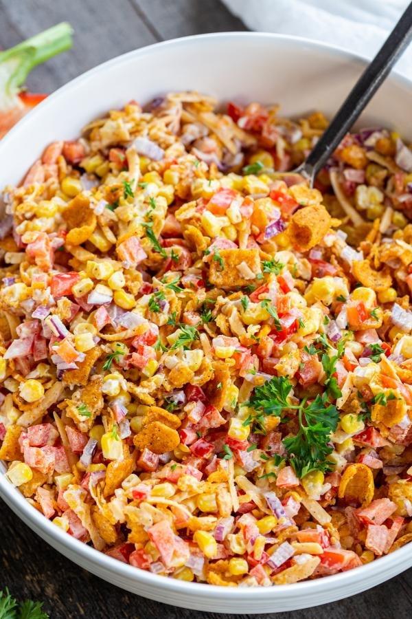 Frito salad in a bowl mixed up