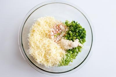cheese, mayo and green onion in a bowl