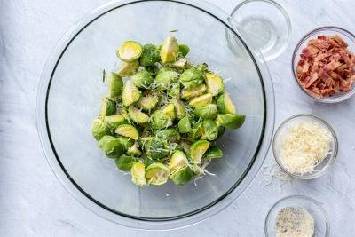Cut Brussels Sprouts in a bowl with seasoning
