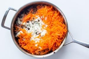 Beef carrots and onion in a frying