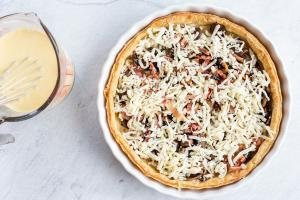 bacon, cheese in a breakfast quiche in a crust