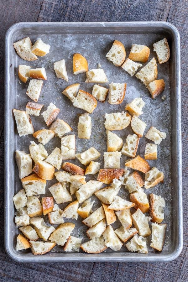 Bread pieces for croutons on a baking sheet
