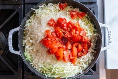 pan with cabbage, rice and tomato