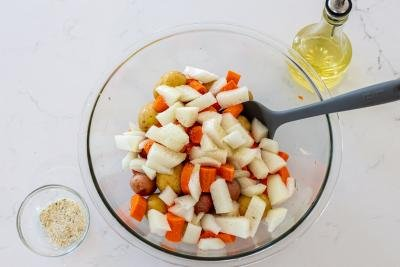 chicken with potatoes and carrots in a bowl