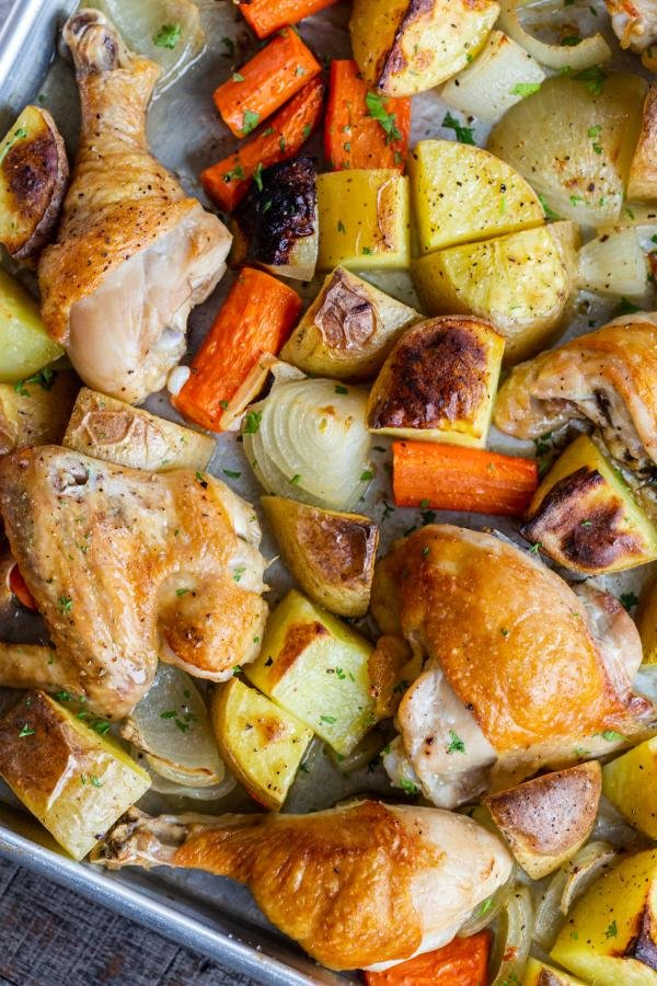 chicken and potatoes on a baking sheet