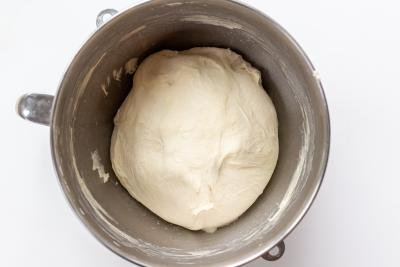 Pizza dough in a mixing bowl