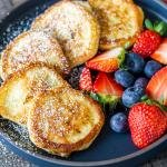 Cottage cheese pancakes on a plate with berries