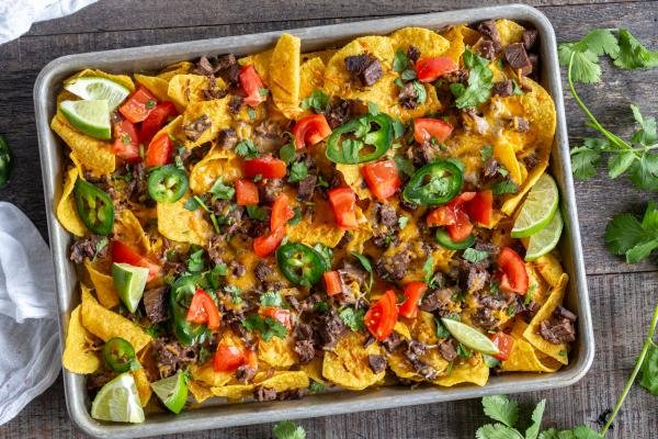 Nacho tray with chips, cheese, veggies and beef