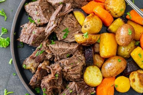 Instant pot pot roast in a palte with potatoes and carrots