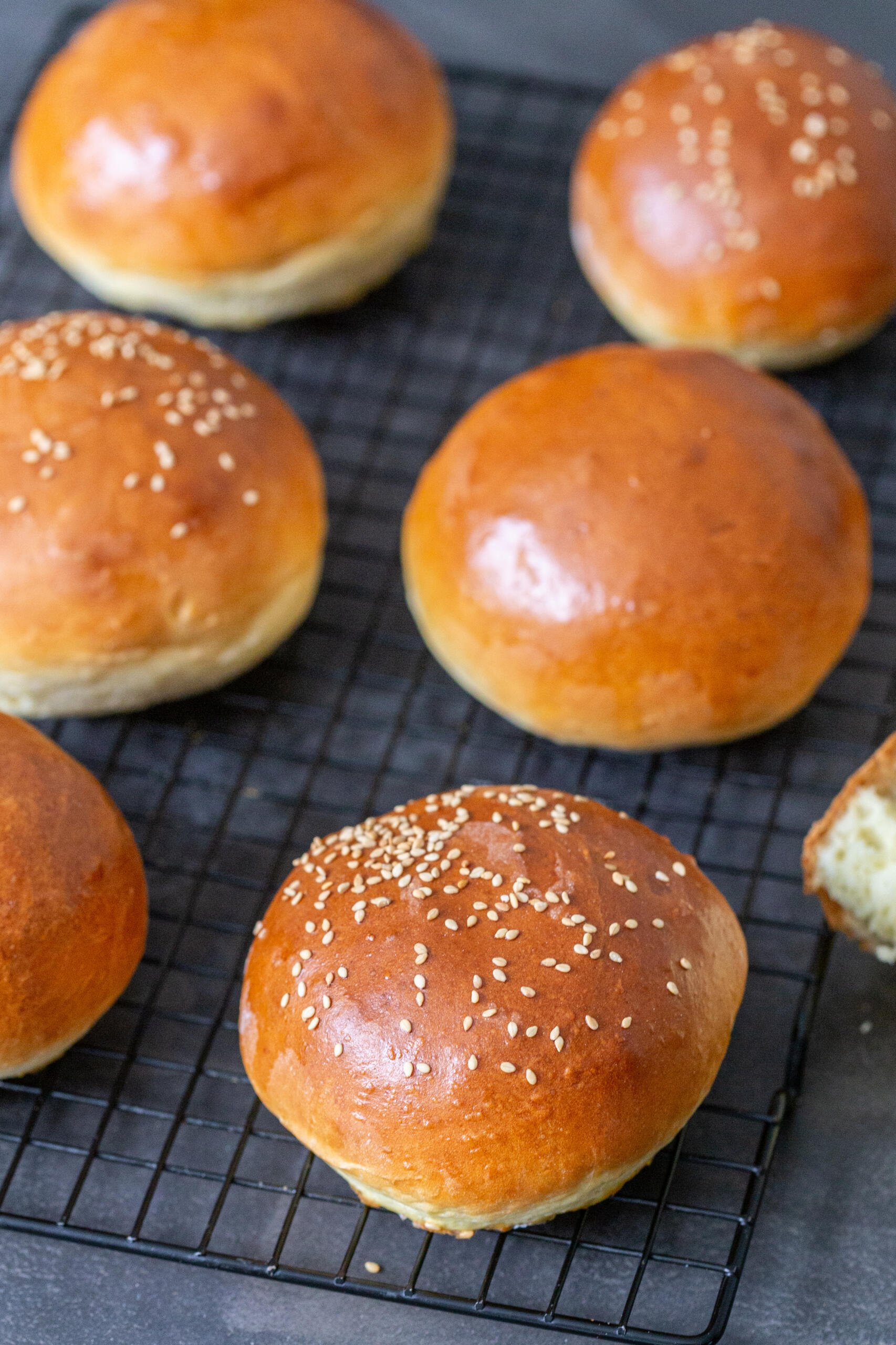 brioche buns on a cooling rack
