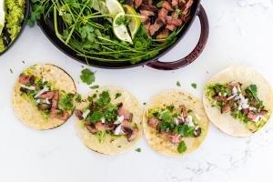 carne asada street tacoson a counter