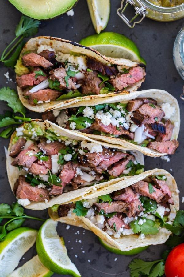 carne asada street tacos on a serving tray