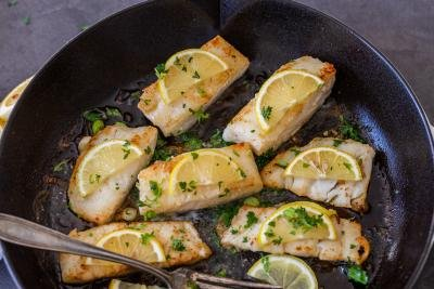Fried cod with butter herbs and lemon