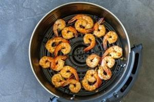shrimp is in a air fryer basket