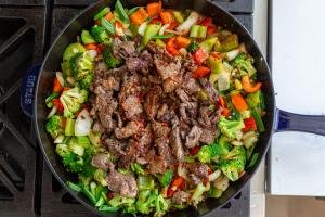 veggies, beef and sauce in the pan