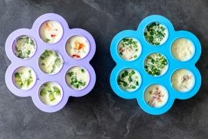 Two molds with eggs and veggies