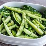 Marinated cucumbers in a serving dish