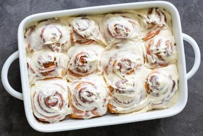 cinnamon rolls with cream cheese on top