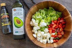 balsamic vinegar and oil next to the salad