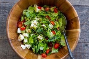 salad tossed together in a bowl