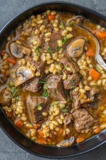 a bowl with beef and barley soup