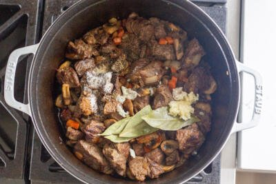 beef and seasoning in a dutch oven