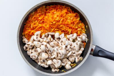 mushroom, carrots and onion on a skillet