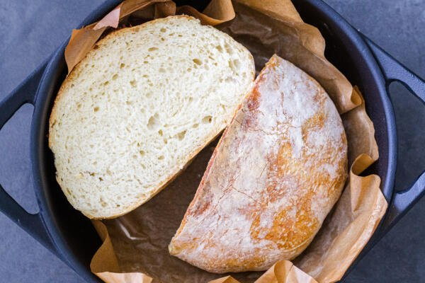 cut open No knead bread in a cast iron