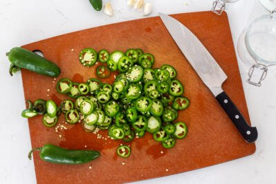 Cut up jalapeños on a cutting board