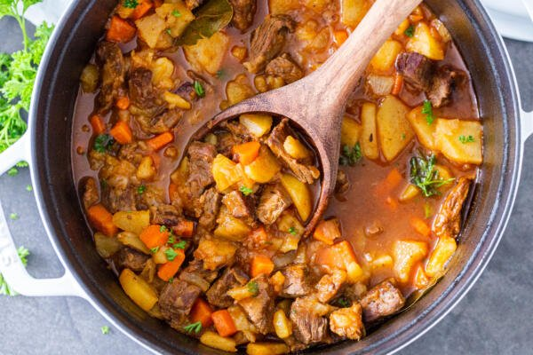 Braised potatoes with beef in a pot